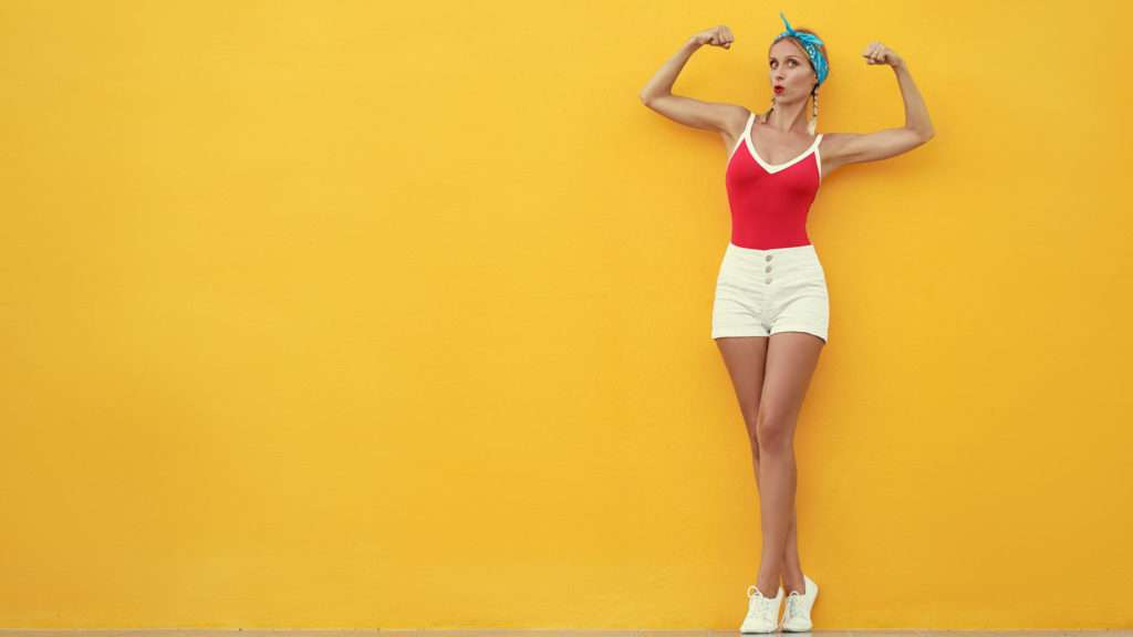 attractive-young-woman-showing-how-strong-she-is-both-mentally-and-physically-by-using-MAXIMUM-MIND