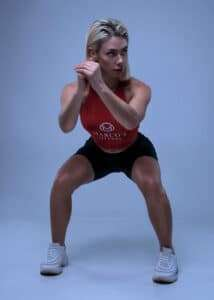 young-attractive-girl-showing-perfect-form-for-squatting