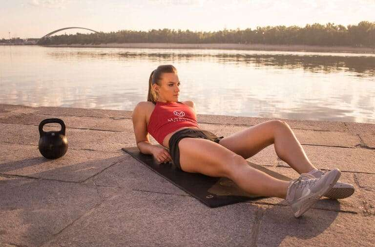 young-attractive-girl-with-kettlebell-at-marco's-grounds