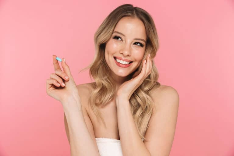 young-attractive-happy-woman-with-a-pill